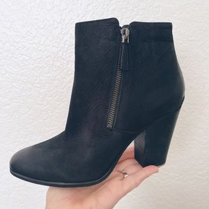 Like New. Michael Kors black leather bootie two zippers and silver logo heel